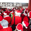 How do you stuff 500 Santas in a Metro train? Very carefully...