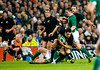Dan Carter is tackled during the International rugby test with Ireland against the New Zealand All Blacks at Aviva Stadium Dublin. November 2010