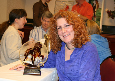 Amy Goddard and her award created by artist Aline Valster
