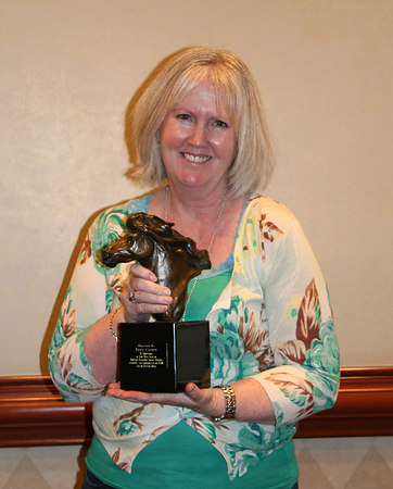 Betsy Covert and her award created by artist Terri Malec
