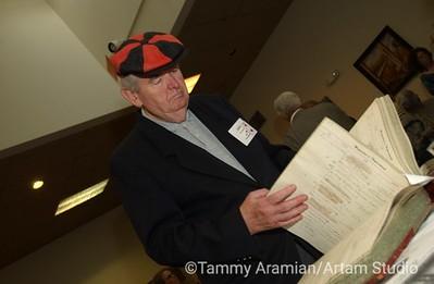 a Poly High alumnus looks through Norm's Hibernia Bank logbook.