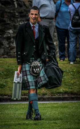 Piper with baggage European Pipeband Championships in Gourock 2006