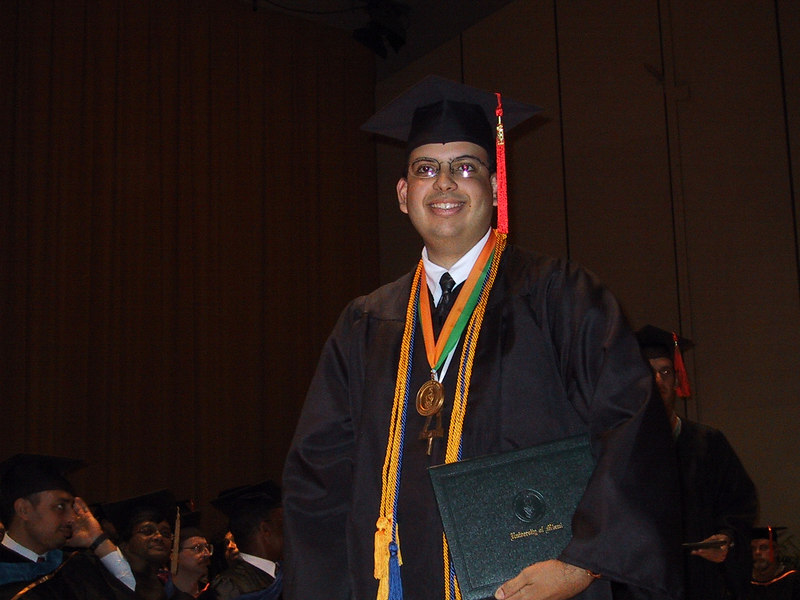 Jonathan smiles as he crosses the stage, having just received his diploma!<br /> <br /> He is decked out in full regalia, including his Honors Medal, his Tau Beta Pi Bent, and Honors Cords.<br /> <br /> His mom grabbed his new S100, ran to the front, and snapped this picture.  He didn't even know she had taken it until he saw it later that night!