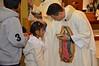 Fr. Joseph blesses a child