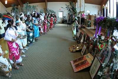 Dancers line the sanctuary in front of altar as they perform a liturgical dance in tribute to Our Lady of Guadalupe.
