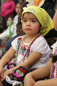 Lupita Cid, three-years-old, watches the Good Shepherd Latino Dancers perform during the post Mass celebration in the gymnasium.
