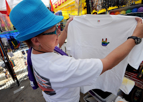 "Nan Propst has made her T-shirt selection at the pride festival.<br /> The 8th Annual Out Boulder Pride Festival was held in Central Park on Sunday.<br /> For more photos and a video, go to  <a href=""http://www.dailycamera.com"">http://www.dailycamera.com</a>.<br /> Cliff Grassmick / August 28, 2011"
