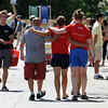 "People walk arm and arm past the booths at the pride festival.<br /> The 8th Annual Out Boulder Pride Festival was held in Central Park on Sunday.<br /> For more photos and a video, go to  <a href=""http://www.dailycamera.com"">http://www.dailycamera.com</a>.<br /> <br /> Cliff Grassmick / August 28, 2011"