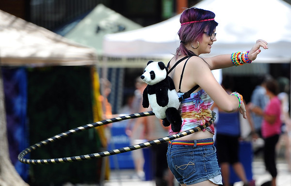 "Kryzten Henderson hula hoops with her panda at the pride festival.<br /> The 8th Annual Out Boulder Pride Festival was held in Central Park on Sunday.<br /> For more photos and a video, go to  <a href=""http://www.dailycamera.com"">http://www.dailycamera.com</a>.<br /> <br /> Cliff Grassmick / August 28, 2011"