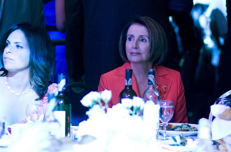 Soledad O'Brien, Medallion of Excellence winner and House Speaker Nancy Pelosi listening to Ozomatli at the Hispanic Caucus Gala on September 16, 2009
