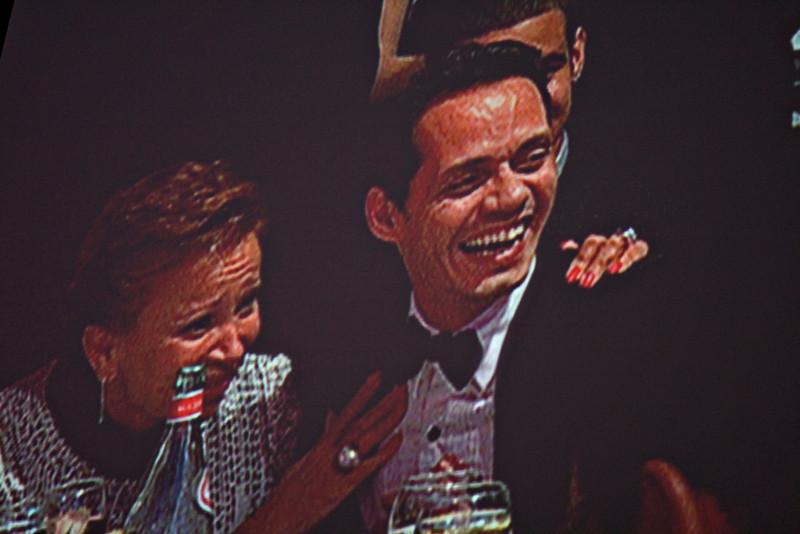 Marc Anthony laughing during President Obama's speech on the big screen at the Hispanic Caucus Gala on September 16, 2009