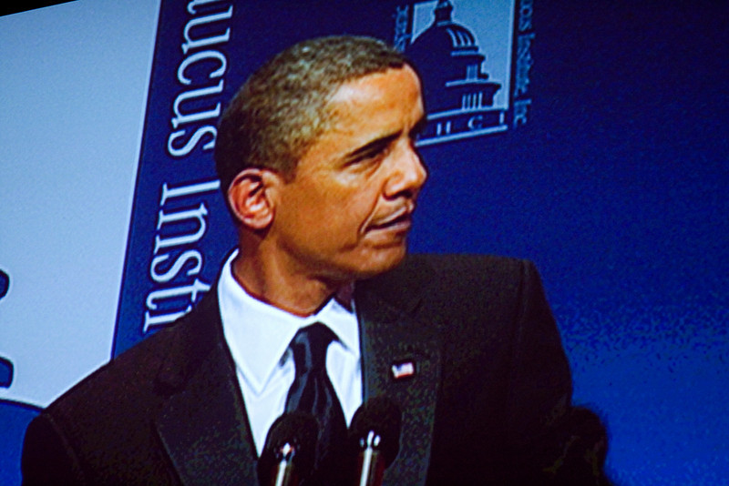 President Obama on the big screen at the Hispanic Caucus Gala on September 16, 2009