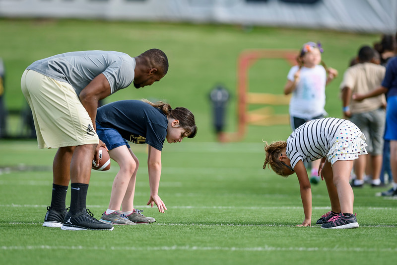 Children participate in football drills during the 2017 PALS camp at Bimel Practice Complex. The camp is designed to engage underserved local youth ages 8-14 in fitness, health and life instruction. (Alex Kumar/Purdue University photo)