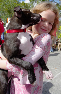 10/25/09—Valerie Yagota, 8, from Kendall gets a kiss from Totsy during the Pawareness pet fair presented by Girl Scout Troop 317 in Pinecrest.