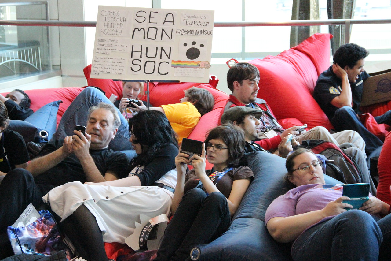 Gamers relaxed at the handheld gaming lounge.