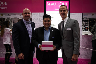 (L-R) Eric Horn, PBA Associate Executive Director, P&G Salon Professional CEO, Reuben Carranza, and PBA Executive Director, Steve Sleeper at Beautique area of Cosmoprof North America. Beautique benefited City of Hope