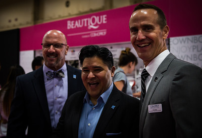 (L-R) Eric Horn, PBA Associate Executive Director, P&G Salon Professional CEO, Reuben Carranza, and PBA Executive Director, Steve Sleeper at Beautique area of Cosmoprof North America. Beautique benefited City of Hope.