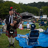 Event Bag Piper taking some time to talk with Fest attendies. (Howard Pitkow/for Newsworks)