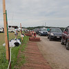 Workers roll up fencing while campers exit the parking lot on Monday morning. (Howard Pitkow/for Newsworks)