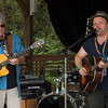 Local artists John Francis (Right) and Jim Dragoni (Left) perform Sunday morning gospal music on the craft stage. (Howard Pitkow/for Newsworks)