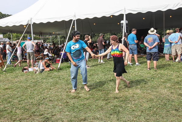 A couple dancing to the blues music outside of the lobby tent stage. (Howard Pitkow/for Newsworks)