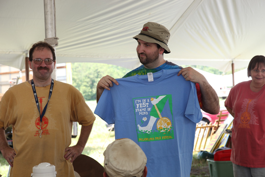 Merchandise committee chairman Rob Morell showing off this years offerings. (Howard Pitkow/for Newsworks)