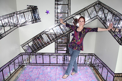 Film Strip booth - for a huge community event - we used fabric for the floor that we found on site, and film strips from the party store.  (and a few stars from the venue decor)