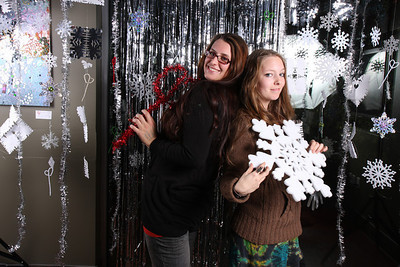 Christmas Photo Booth with themed decor as well as event specific decorations, hand-made. :)  With a sparkly door decoration and lots of snowflakes!