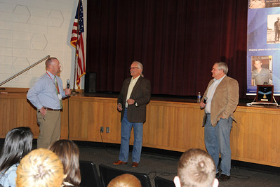 Photos by Carl Hess. Rich and Cory Etchberger talk to Hamburg Area High School students about their dad, Chief Dick Etchberger.