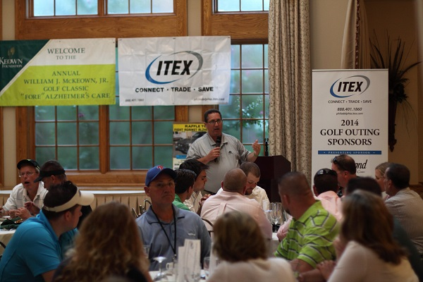 Frank Hueber, of ITEX, speaks to the crowd at the Swing Away Alzheimer's Challenge for Charity golf tournament to support the McKeown Foundation.