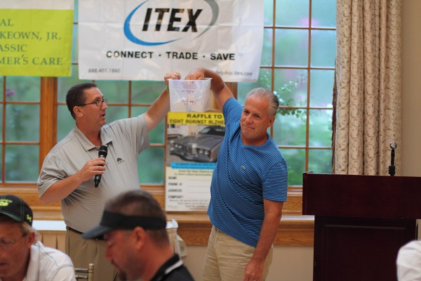 Joe McKeown draws the name of the winner of a 1971 Mercury Cougar XR7 show car at the Swing Away Alzheimer's Challenge for Charity golf tournament to support the McKeown Foundation held at Talamore Country Club in Horsham Tuesday Sept. 2.