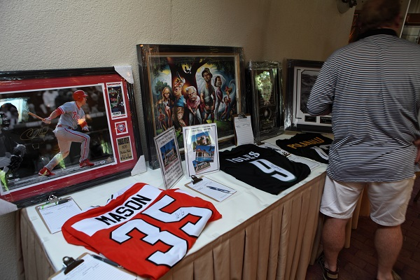Guests browse items up for bid during the silent auction at the Swing Away Alzheimer's Challenge for Charity golf tournament.