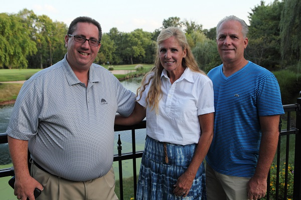 Frank Hueber, of ITEX, and Joe and Kathy McKeown of The McKeown Foundation pose for a photo at the Swing Away Alzheimer's Challenge for Charity golf tournament, supporting the McKeown Foundation, held at Talamore Country Club in Horsham Sept. 2.