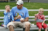 Andrew Trella and his sons, Nolan, left, and Keenan eat ice cream on the baseball bleachers at Deep Meadow Park during Horsham Day June 6, 2015.<br /> Bob Raines--Montgomery Media