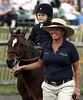 Reese Sides, 3, and her riding instructor Diane Daly head for the Leadline Class competition at the June Fete Horse Show June 6, 2015.