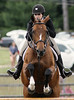 Brandi Doak jumps Pandora K in the National Hunter Derby at the June Fete Horse Show Saturday, June 6, 2015.<br /> Bob Raines--Montgomery Media