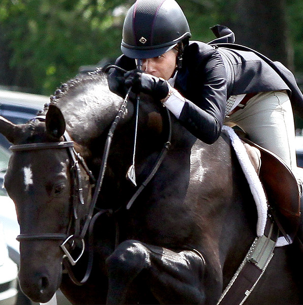 Rebecca Gibson jumps Grand Luxe in the National Hunter Derby at the June Fete Horse Show Saturday, June 6, 2015.<br /> Bob Raines--Montgomery Media