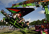 Three teens take flight on the Cliff Hanger hang glider ride at the June Fete Village Festival Saturday, June 6, 2015,<br /> Bob Raines--Montgomery Media