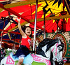 Sophie Juhas waves as she rides on the carousel at the June Fete Village Fair Saturday, June 6, 2015.<br /> Bob Raines--Montgomery Media
