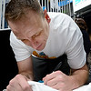 Joey Chestnut signs a fans T-Shirt