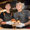 (L) Andie Nguyen of San Jose and Lance Dayrit of San Jose prepare chicken sandwiches at Santa Clara Valley Brewing Company's final night