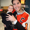 Nathan Yocum and his daughter in the Shark Tank for Flyers vs. Sharks