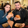 Delma Hernandez  of San Jose and Alvaro Vazquez of Milpitas enjoy a chicken sandwich and a beer at Santa Clara Valley Brewing Company's final night