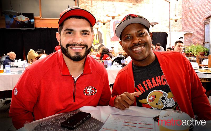 Patrick Alvarez (L) of San Jose and CJ Thomas of San Jose at Rookies Sports Bar and Grill in Downtown San Jose
