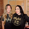 Kiara Kobayashi (L) and April Sanchez celebrate during Airfield Supply Company's 10 year anniversary party at 71 Saint Peter