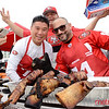 NFC Championship - Levi Stadium - James Wilcenski (L) and his cook crew show off thier Tomahawk Steaks