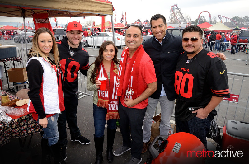 California State Assembly member Ash Kalra (red shirt) enjoys some tailgating before the NFC Championship at Levi Stadium