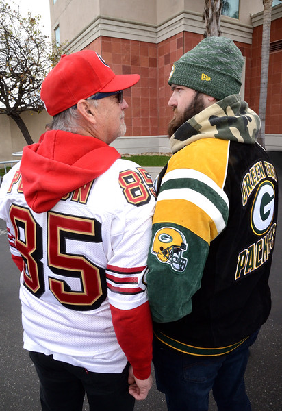 NFC Championship - Levi Stadium - Mike Trudeau (L) with Green Bay fan (and son) Brock