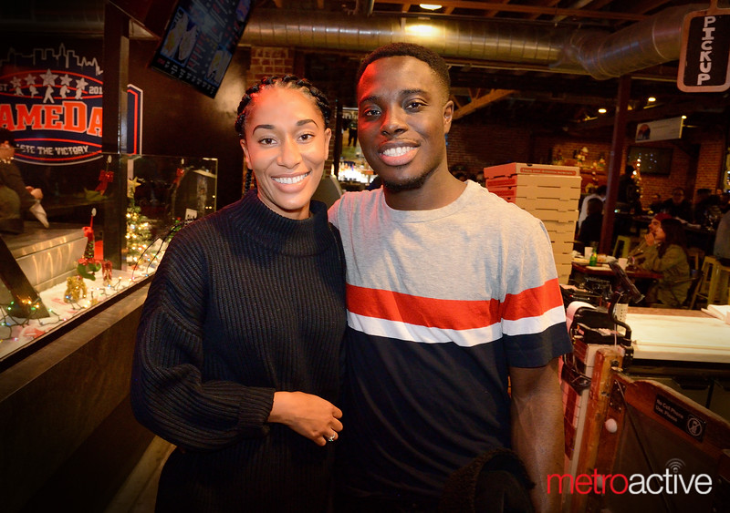 """Najah Simmons (L) and Kwame Odame both of San Jose on a """"date night"""" at San Pedro Square Market"""