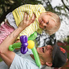 Kyle Restad holds daughter Morgan up high at The Petaluma Mother's Club  Easter Egg Hunt at McNear Park on April 12, 2014